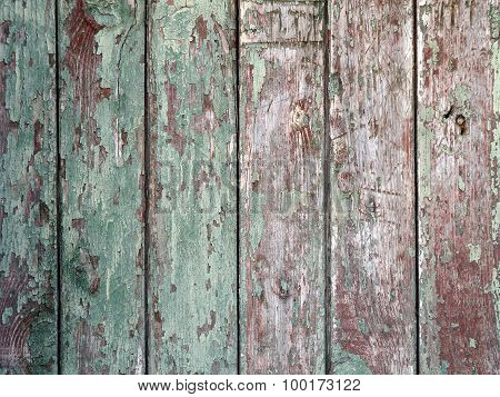 Detail Of An Old  Vertical Wooden Fence