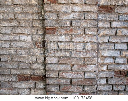 Fragment Of A Wall Of An Old Red Brick With White Coating