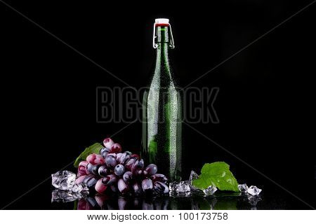 Wine Bottle With Red Grape