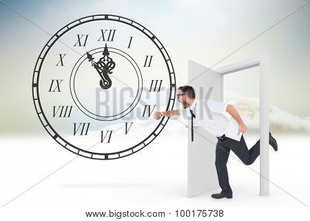 Geeky young businessman running late against open door in sky