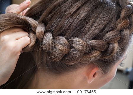 braided plait brunette at the beauty salon