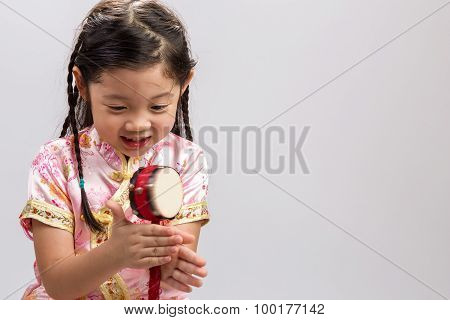 Girl Playing Toy Drum Background / Girl Playing Toy Drum / Girl Playing Toy Drum On White Background
