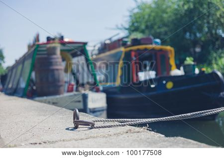 Rope And Houseboats By Canal