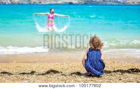 Mother And Child Having Fun At The Beach