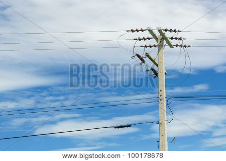 High Voltage Power Pole With Blue Sky