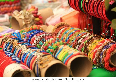 Multi-colored ethnic bracelets. Esoteric jewelery. Indian decorations on the wrists.