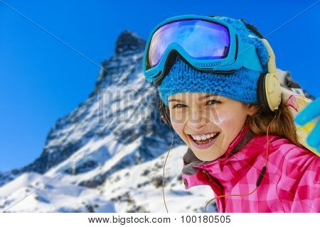 Young skier with view of Matterhorn on a clear sunny day  - Zermatt, Switzerland