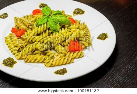 Dish Of Pasta With Pesto Genovese Sauce And Vegetables, Tomato And Basil
