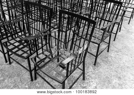 Vintage Black Chairs Stand In A Row