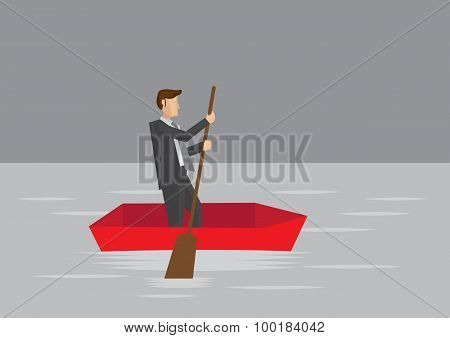Businessman Paddling In Small Boat