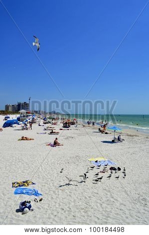 Clearwater Beach, Florida, USA - May 12, 2015: tourists on the beach enjoying the sun