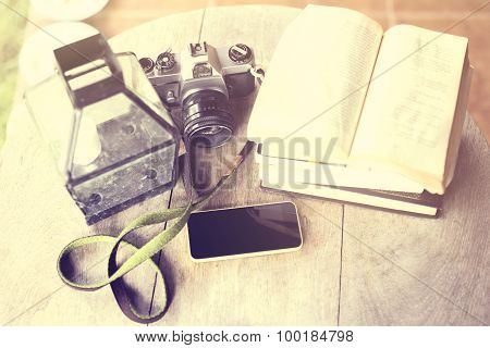 Cell Phone, Old Camera And Book On A Wooden Table, Vintage Photo Effect
