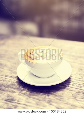 Cup Of Cappuccino On Wooden Table Outdoor