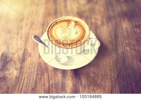 Cup Of Cappuccino On A Wooden Table, Vintage Photo Effect