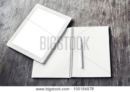 Blank Digital Tablet With Blank Diary And Pencil On A Wooden Table, Mock Up