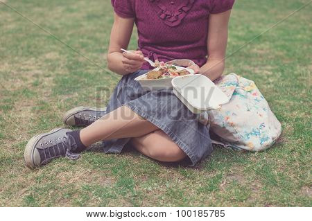 Woman Eating Falafel In Park