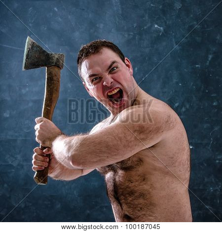 Angry, aggressive man brandishing an ax