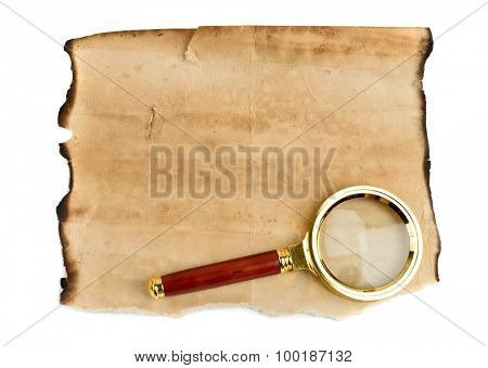 Old grunge blank paper sheet with Magnification Glass