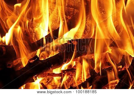 Logs And Branches Burning In A Wood Fire