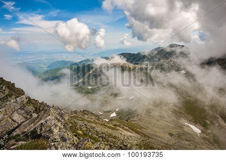 Landscape in clouds of Retezat National Park mountains in South Carpatians, Transylvania, Romania, Europe.