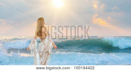 Beautiful stylish woman walking on the beach