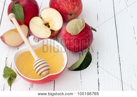 Apple and honey traditional food of jewish New Year - Rosh Hashana. Copyspace background