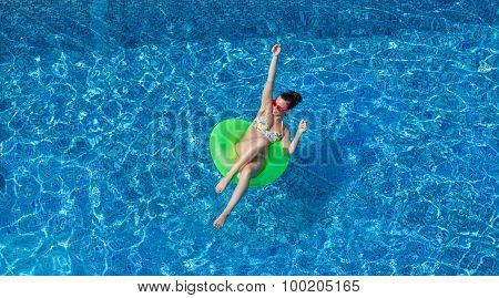 Happy Young Sexy Woman On Swimming Circle In Swimming Pool