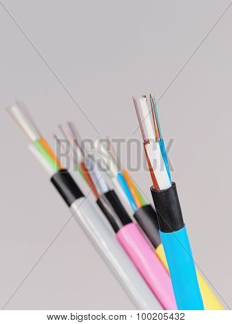 Blue fiber optic cable with stripped and  exposed fibers