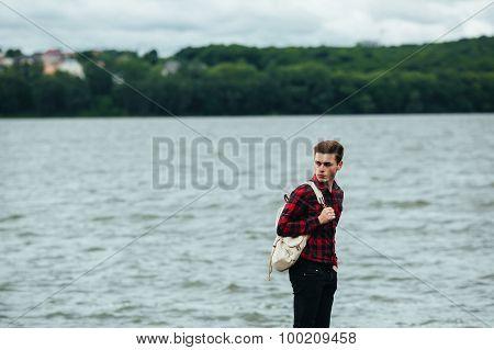 man standing on a pier