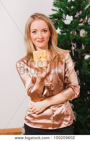 Blonde haired woman with small gift