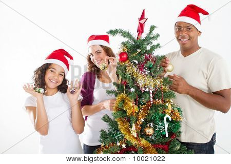young family decorating christmas tree