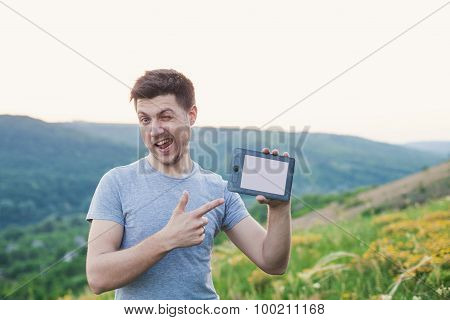 Man Hold An Ebook And Winks Eye