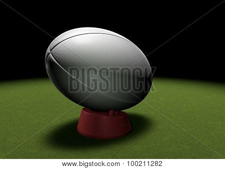 Rugby Ball On Kicking Tee Under Spotlight