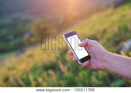 Men`s Right Hand Is Holding A Phone