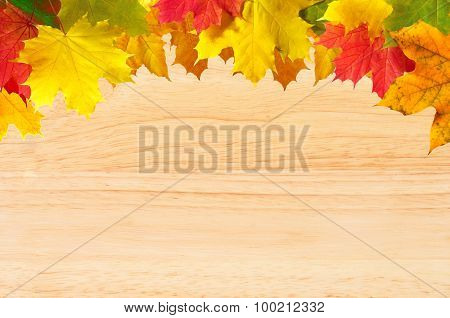 Autumn Maple Leaves Over Wood Texture Close-up