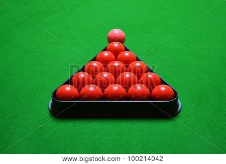 Snooker balls set on green table