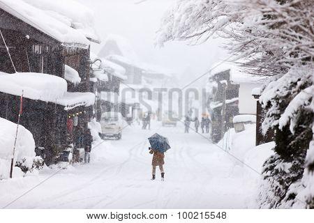 Historic Japanese village Shirakawa-go at winter under heavy snowfall, travel landmark of Japan