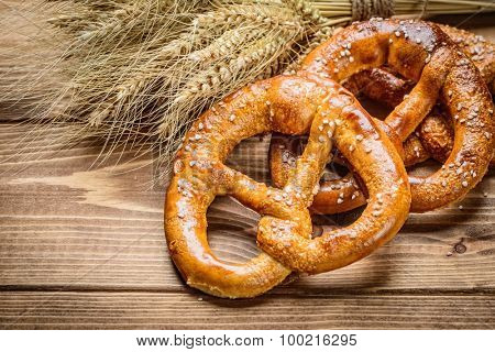 fresh pretzel  and wheat on the wooden