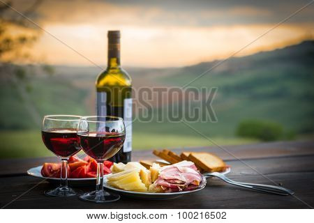 still life Red wine  ,cheese and prosciutto. Romantic dinner  outdoors