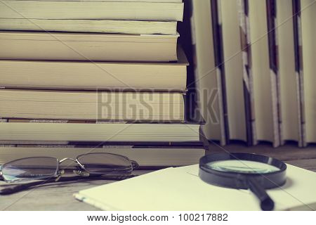 Magnifying Glass And Books On Table, Vintage Effect Style