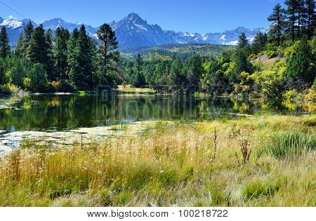Lake And Snow Covered Mountains During Foliage Season