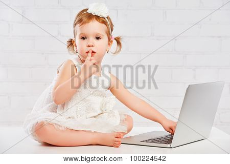 Little Child Baby Girl Works At Computer At Home