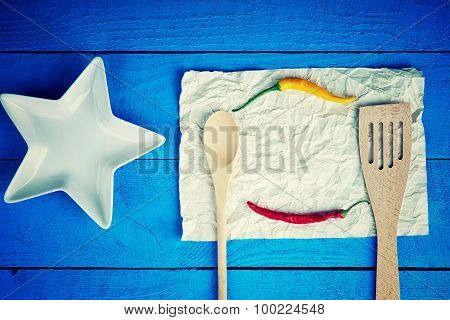 Kitchenware, plate and hot chili pepper on a sheet of paper