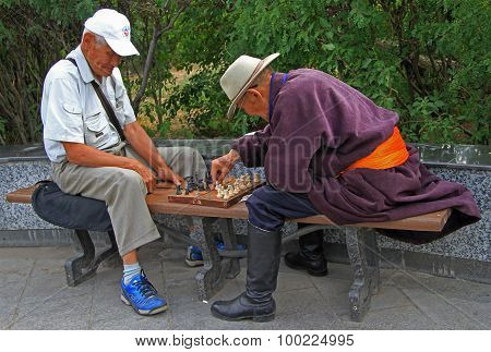 two old men are playing chess in park of Ulaanbatar, Mongolia