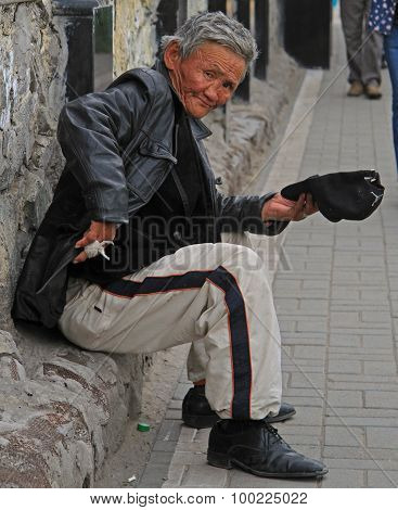 beggar is trying to get some money on the street in Ulaanbaatar
