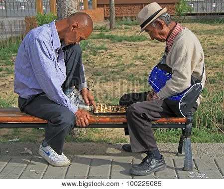 two men are playing chess in park of Ulaanbatar, Mongolia