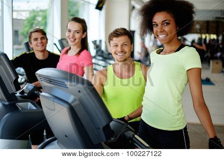 People on a elliptical training machine in a gym