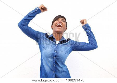 Young African American Woman Cheering With Arms Raised