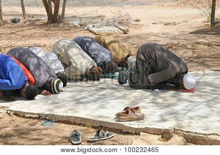 Muslims Praying In Congregation Outside, Islamic Prayer