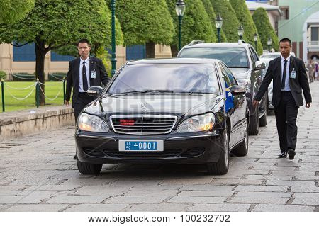 Body Guards Protect State Automobile, Which Moves In The Grand Palace In Bangkok.